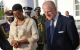 First Lady Janet Museveni and Prince Phillip walk past the Service Chiefs