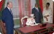 Queen Elizabeth signs the Guest Book upon her arrival at State House Entebbe