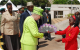 The Queen receives a bouquet of flowers upon her arrival at the Parliament