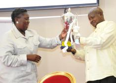 President Museveni receiving his NFFU trophy from Speaker Kadaga at Entebbe
