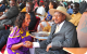 Women's Council Chairperson Rosemary Najjemba chatting with President Museveni