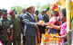 President Museveni receiving the products during the exihition by women