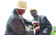 President Museveni decorating Mzee Othondhe a senior committed citizen with Luwe