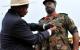President Museveni  decrating Col Mukumbi with Luwero Triangle medal