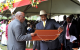 President Museveni looking at the potriat of fallen fighter given to him by Luwe