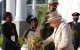 Queen Elizabeth receives a bouquet of flowers upon her arrival at State House En