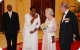 First Lady Janet Museveni whispers to Queen Elizabeth II