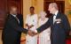 Vice President Gilbert Bukenya greeting Prince Phillip