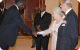 Works Minister Eng. John Nasasira greeting Queen Elizabeth II