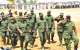 Members of Parliament march at the 26th NRM Anniversary