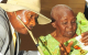 President Yoweri Museveni talking to the widow of Late Naliima