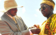 President Museveni decorating Major Roland Kakooza Mutale with Katong Medal