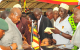 President Museveni attends to fellow fighters after the function.