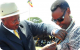 Double Medalist Janet Museveni being decorated by President Museveni at Lira
