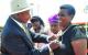 President Yoweri Museveni decorating Joy Mugyenyi with Nalubale medal