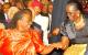 Former VP Wandira Kazibwe shares a light moment with Rebecca Garang