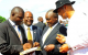 L-R; US based Ugandan Kalungi Kabuye, Kira Mayor Mamerito Mugerwa, V.P Bukenya a