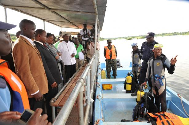 Police divers standing besides the President after surveying the route at Nabuga