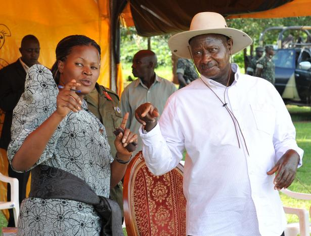 President Museveni  talking to Kayunga district MP Nantaba at a rally  at Nekoye