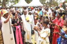 From left. Mrs Janet Museveni (in hut waving) with Woman MP Mubende Benny Namugw
